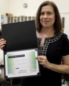 Margot Heffernan accepts the Tutor Merit Award from the Skyline Literacy Coalition